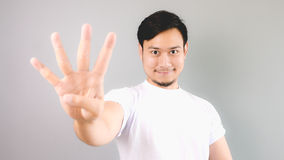 Four hand sign. An asian man with white t-shirt and grey background stock photos