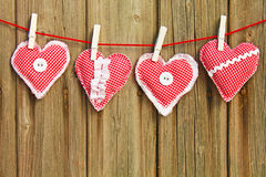 Four hand-stitched hearts Royalty Free Stock Photo