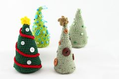 Four Handcrafted Tabletop Christmas Trees Royalty Free Stock Photos