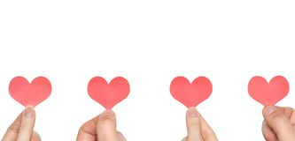 Four hands four hearts Royalty Free Stock Photos