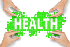 Four hands with health puzzle Royalty Free Stock Image