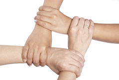Four hands holding another Stock Images