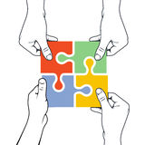 Four hands joining puzzle piece - association concept. Four hands joining puzzle piece - association and merger concept Stock Photos