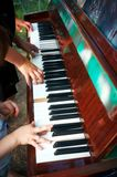 Four hands played on the old piano royalty free stock image