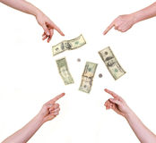Four hands pointing at money Stock Image