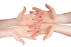 Four hands. Symbolizing team and support, isolated Stock Photos