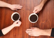 Four Hands on the table Royalty Free Stock Photo
