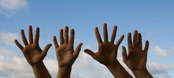 Four hands waving Stock Photo