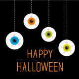 Four hanging eyeballs. Happy Halloween card. Royalty Free Stock Image