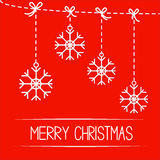 Four hanging  snowflakes. Merry Christmas card. Stock Photography