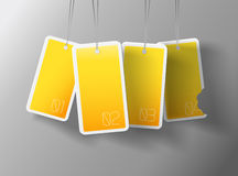 Four hanging yellow cards. Royalty Free Stock Photos