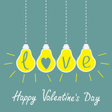 Four hanging yellow light bulbs with word love. Id Stock Photo