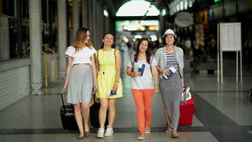 Four happy female travellers with luggage at the airport. Summer vacation, travelling concept. Four Happy Female Travellers with Luggage at the Airport. Summer stock video