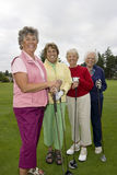 Four Happy Golfers Stock Photo