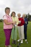 Four Happy Golfers Stock Photo