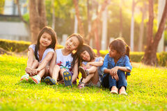 Four happy smiling child playing in park Stock Images