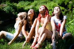 Four happy teen girl friends looking together in one direction Royalty Free Stock Photography