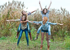 Four happy teen girls friends having fun outdoors Royalty Free Stock Photos