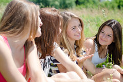 Four happy teen girls sharing secrets Royalty Free Stock Photography