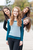 Four happy teenage friends Stock Photography