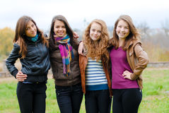 Four happy teenage friends Royalty Free Stock Images