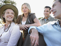 Four Happy Tourists Sitting In Jeep Royalty Free Stock Photography