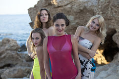 Four happy women stock photography