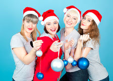 Four happy women with new year balls Stock Photography