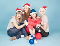 Four happy women with new year balls smiling stock photography
