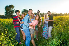 Four happy young couples having a party. Royalty Free Stock Images