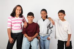 Four happy young ethnic school children Stock Photo