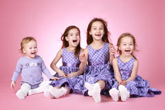 Four Happy young girl in violet dress laugh Royalty Free Stock Photography
