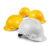 Four hard hat team. Four hard hat work team, protective safety helmets isolated Stock Image
