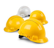Four hard hat team. Four hard hat work team, protective safety helmets isolated Royalty Free Stock Images