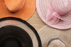Four  hat lying on the undulating sand Stock Images