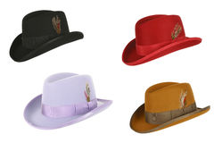Four hats. Of different colors on a white background Royalty Free Stock Photo