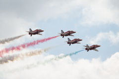 Four Hawk T1 jets on air show. Air show, four Hawk T1 jets with colored smoke on air show stock images