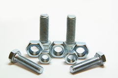 Four head bolts and five screw nuts Royalty Free Stock Image