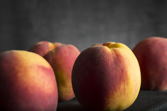 Four Healthy fresh peaches Stock Image