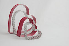 Four heart-shaped cookie cutters resting on sides Royalty Free Stock Image