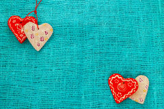Four heart on a turquoise background St. Valentine`s Day Royalty Free Stock Photo