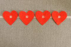 Four hearts. From felt gray background royalty free stock photography