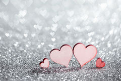 Four hearts on glitters Royalty Free Stock Images