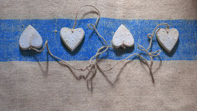 Four hearts linked together with rope Royalty Free Stock Image