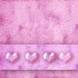Four hearts pink background Royalty Free Stock Images
