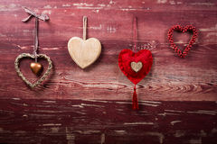 Four hearts on red board Stock Image