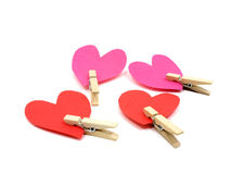 Four hearts with wooden pins. On each heart on white background Stock Image