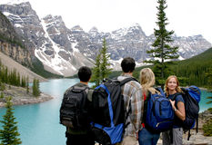 Four Hikers. Overlooking Lake Moraine Royalty Free Stock Photos