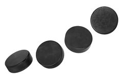 Four hockey pucks Royalty Free Stock Images