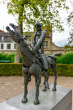 Four Horsemen of the Apocalypse. Sculpture group The Four Horsemen of the Apocalypse by Rik Poot at the Hof Arents in Bruges / Brugge, West Flanders, Belgium Stock Photo